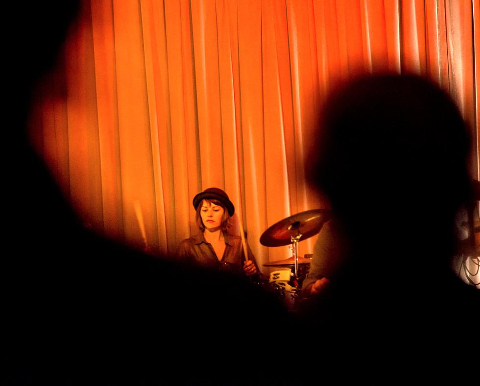 Drummer in Black and Orange