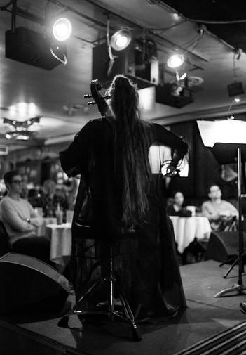 Cellist With Very Long Hair