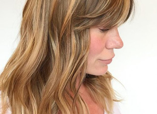 Medium Layered Haircut with Side Swept Bangs