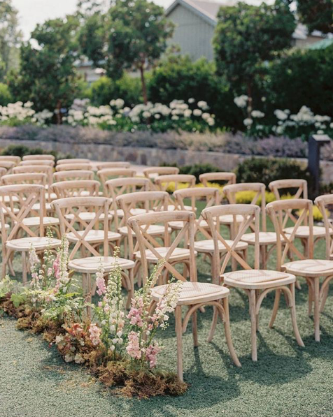 Outdoor wedding ceremony with crossback chairs