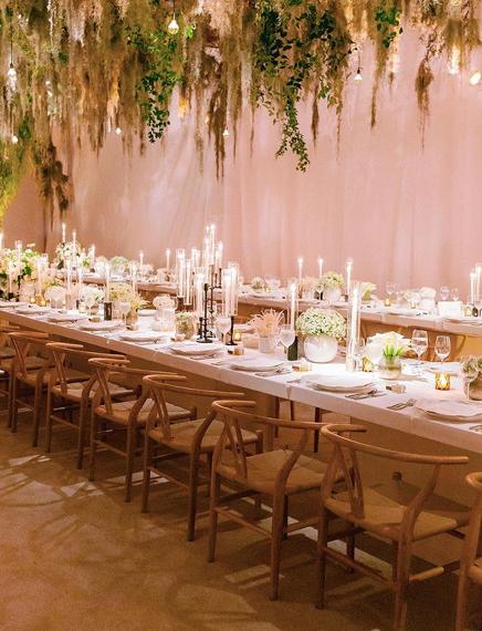 hailey baldwin wedding reception with wishbone chairs