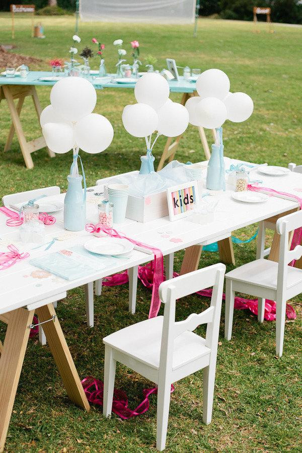 white kids table at wedding reception