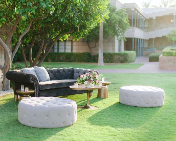 velvet furniture in a lounge area at an outdoor wedding reception