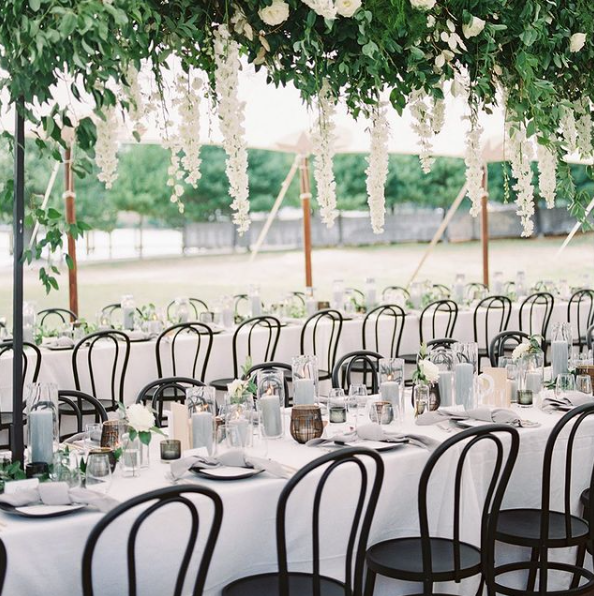 tent wedding reception with black bentwood chairs