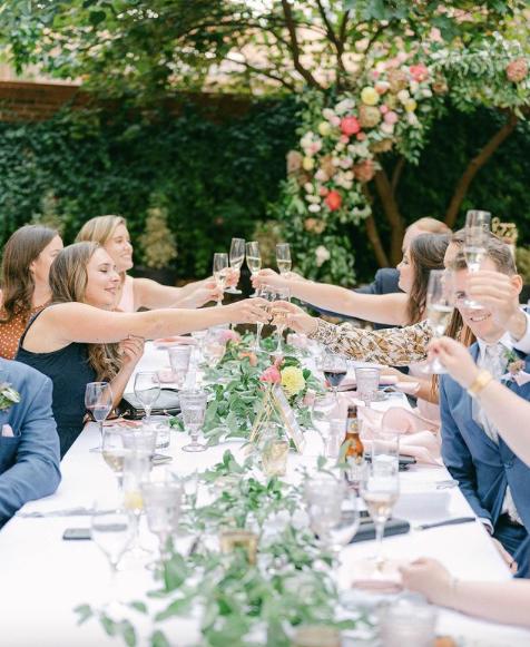 wedding head table cheersing