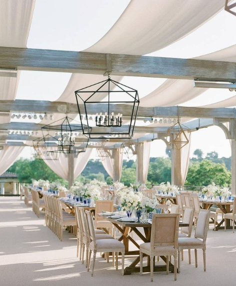 outdoor wedding reception with earthy neutral tones and modern details