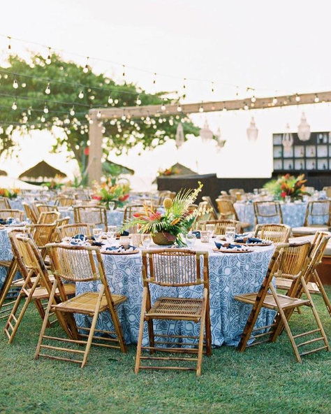wedding reception with rattan folding chairs