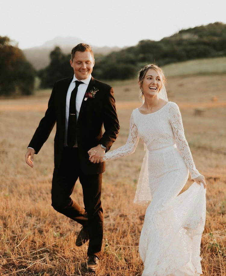 bride wearing eco-conscious wedding dress made by Reformation