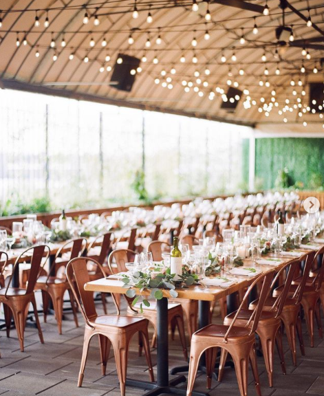 warehouse wedding reception with copper marais chairs