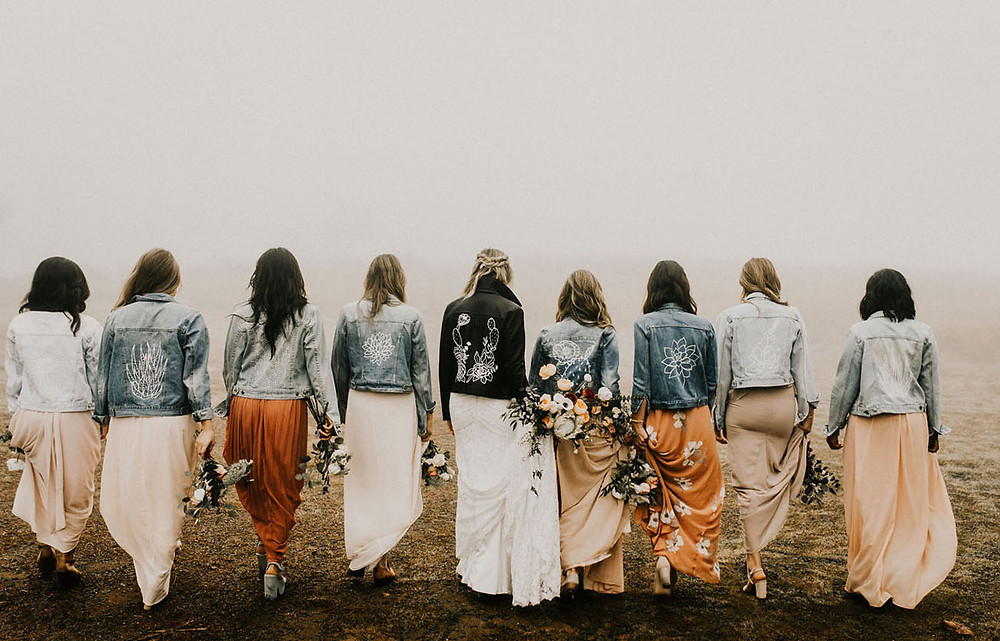 bridesmaids in matching denim jackets