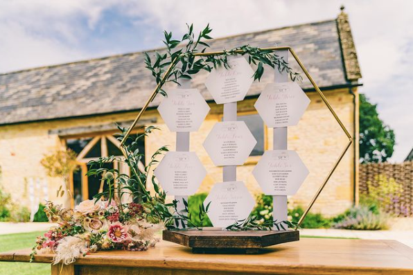 wedding seating chart with geometric details outside of wedding venue
