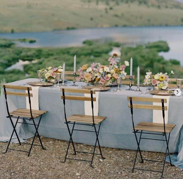 wedding reception with french bistro folding chairs