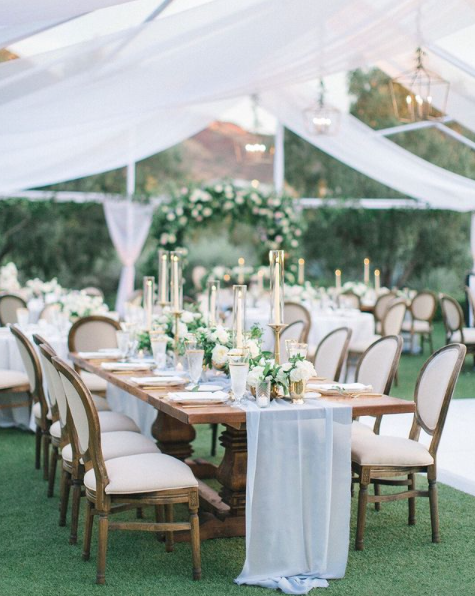 tent wedding reception with louis chairs