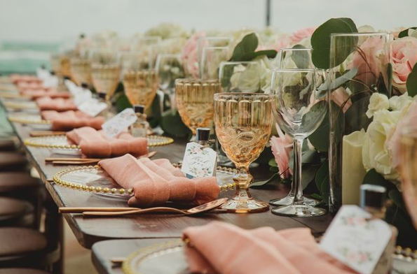 amber colored water goblets on wedding dining table