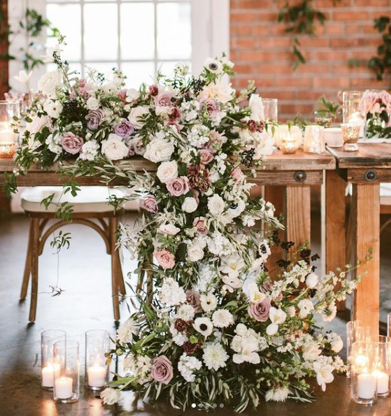 long cascading floral garland surrounded by candle votives