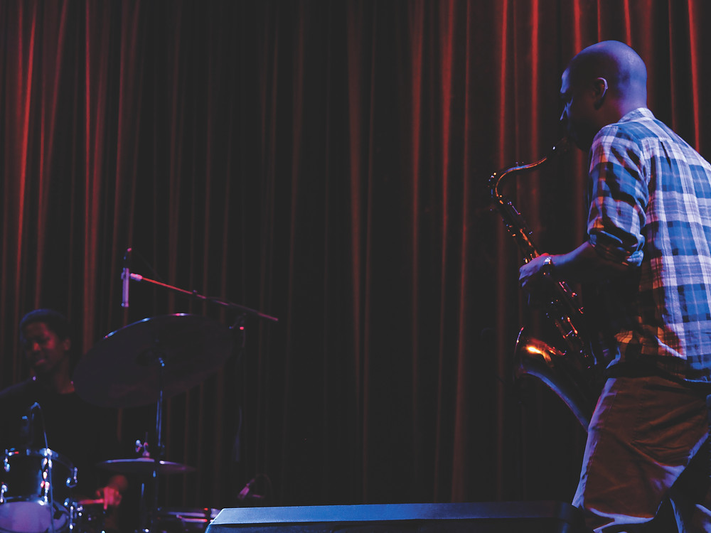 Jazz artists Binker & Moses on stage at GCT in front of our red curtains in 2017