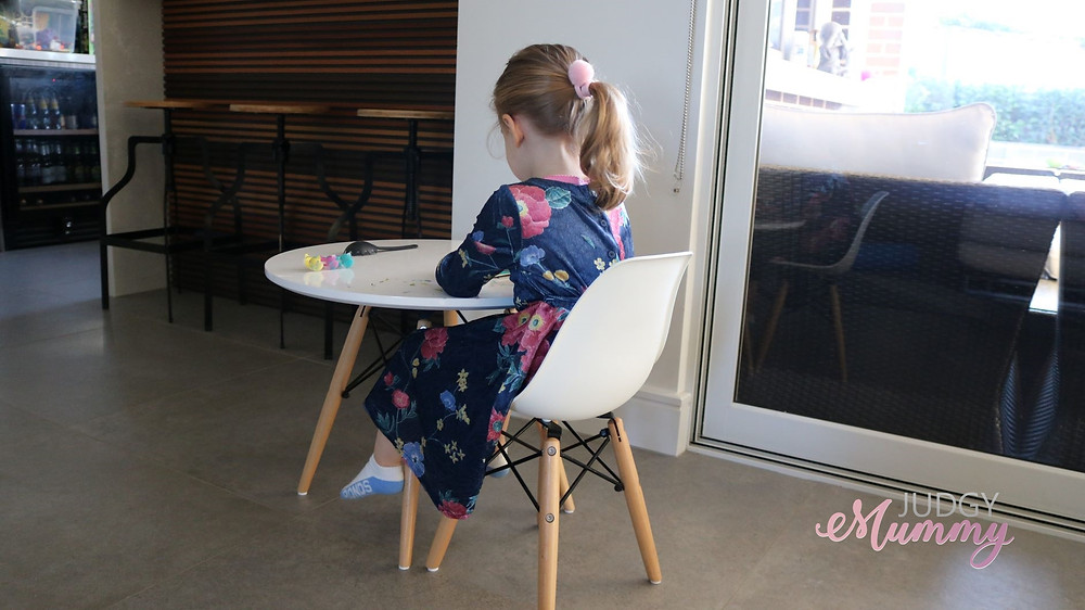 Little Miss sitting at a table