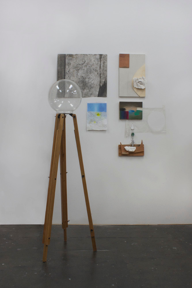 Catalogue, 2014 | Tripod, glass, graphite on paper, wood, plaster molds, mark text on paper, ink-jet printing, oil on canvas, plastic, spearhead and rope | 178 x 126 x 97 cm