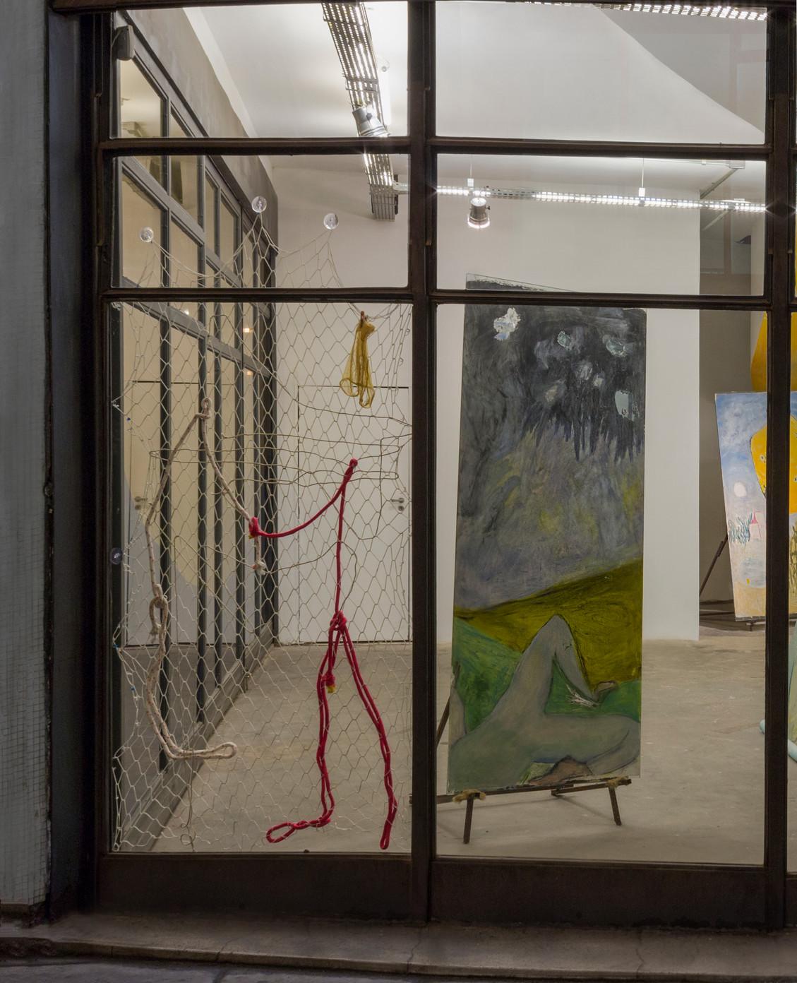 The tie, 2018 |  Nylon net, clothes and sisal | 183 x 108 cm
