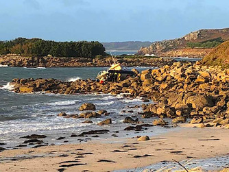 Tresco jetboat beached on rocks in storm