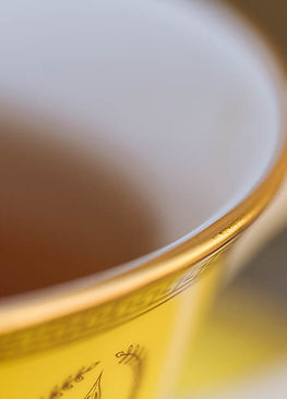 Bright yellow bone china teacup finished with 24 carat gold.