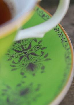 beautiful bright green tea cup in bone china