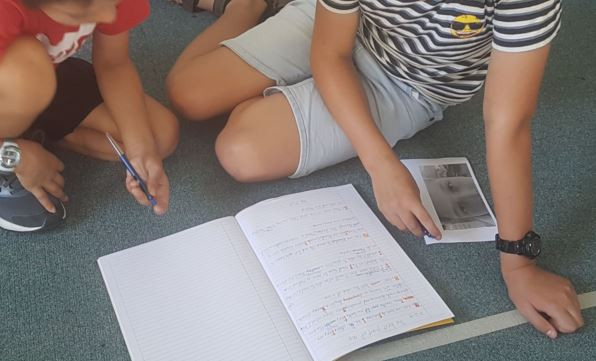 Talk buddies reading their writing to each other.