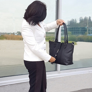 Rome - A classic black leather handbag