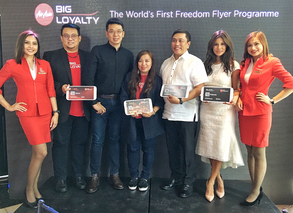 AirAsia representatives with Captain Dexter Comendador (3rd from right) AirAsia PH CEO and said Sereen Teoh (middle), acting CEO for AirAsia BIG Loyalty