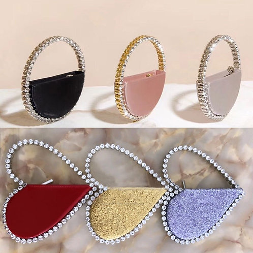 Clutch rounded or heart shaped bag