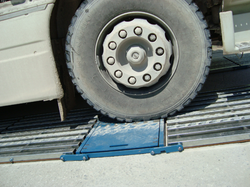Portable__in_motion_axle_weigher_wheel.png