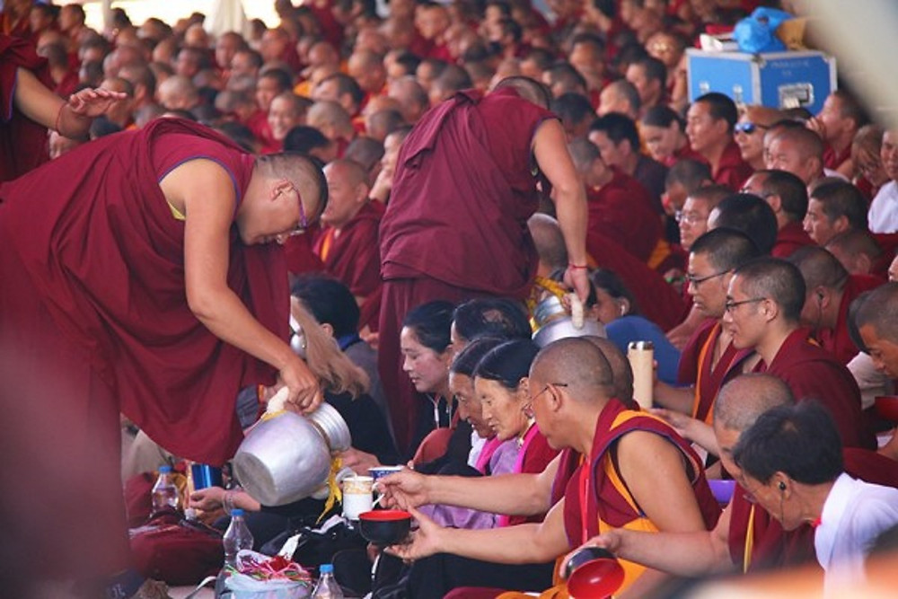 Monks prepare and serve free tea and lunch to over 30,000 attendees of Buddhist teachings in new prayer hall of Tashi Lhunpo.