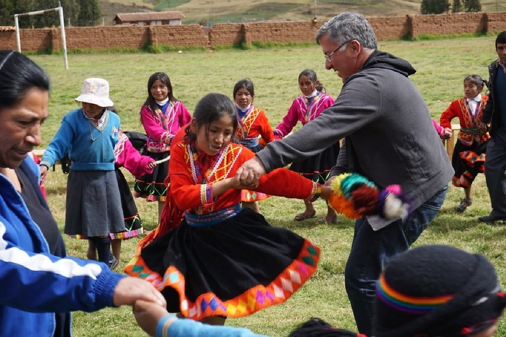 Trip Leader Fernando dancing with Peruvian community