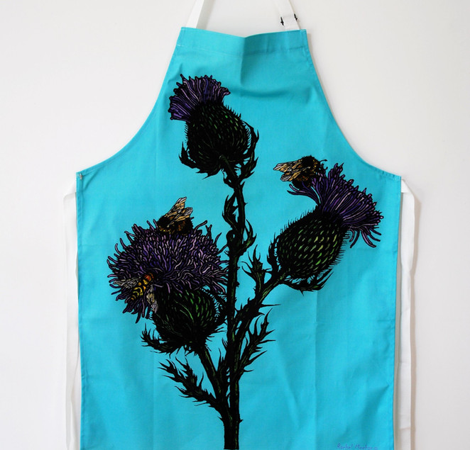 Thistle & Bee apron on Blue