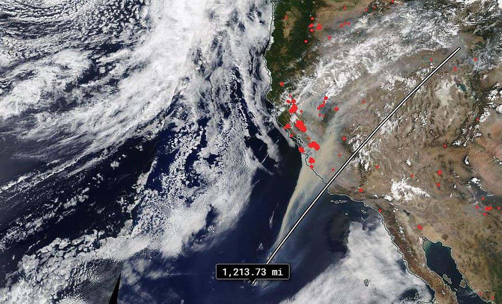 Trail of smoke seen at California after the wild fires. The orange dots represent the fires