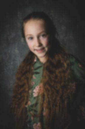 Ook maakt professionele fotograaf Nikki Hoff tijdens een kindershoot van iedereen apart een mooie portretfoto.   Headshot of a pretty young girl. Professional kids photographer.
