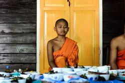 Novice Monk Awaits Lunch
