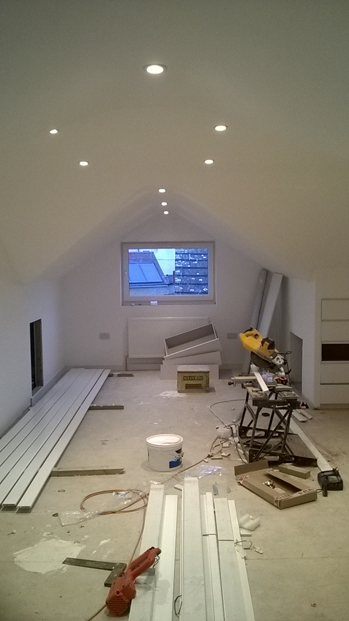 a loft conversion has been plastered and painted, now with new skirting boards and built in bedside cupboards.