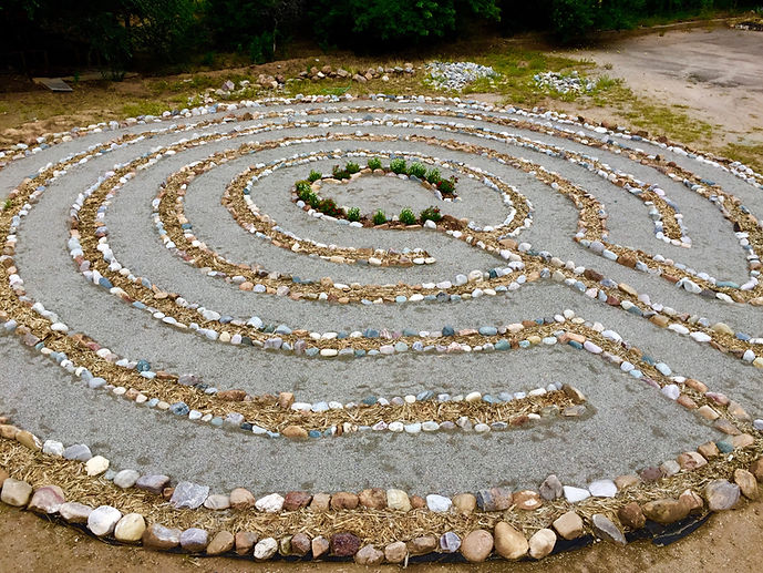 The labyrinth is an ancient pattern found in many cultures around the world. Labyrinth designs were found on pottery, tablets and tiles that date as far back as 5000 years. Many patterns are based on spirals and circles mirrored in nature. In Native American tradition, the labyrinth is identical to the Medicine Wheel and Man in the Maze.  The labyrinth is a walking meditation, a path of prayer and an archetypal blueprint where psyche meets Spirit. It has only one path that leads from the outer edge in a circuitous way to the center.  It is a path of prayer, a walking meditation, a crucible of change, a watering hole for the spirit and a mirror of the soul.
