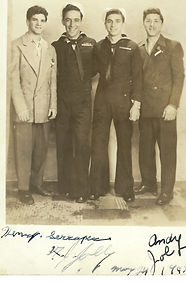 A Jolly (2nd from left) and unidentified