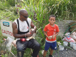 Bro Anderson and his son Isaiah, supporting the work of the Hope centre to rebuild Shada's home