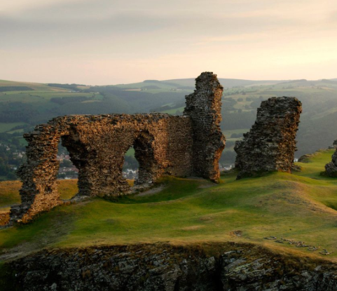 Castle Dinas Bran hunched on a hill above Llangollen