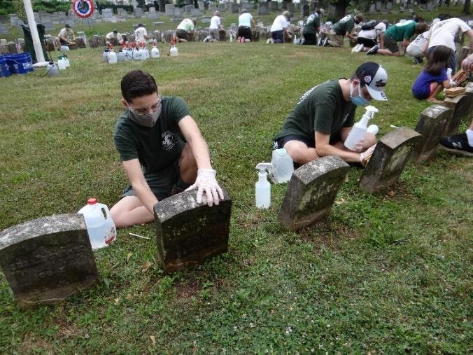 Unit 305 Scouts, HCGHS members, community volunteers, and family helped restore veterans headstones in the inner row of Soldiers' Circle at Arlington Cemetery in Kearny as the Eagle Project for Eliot Jablonski, Life Scout and Assistant Senior Patroller of Unit 305 (photo courtesy of Unit 305 in Kearny)