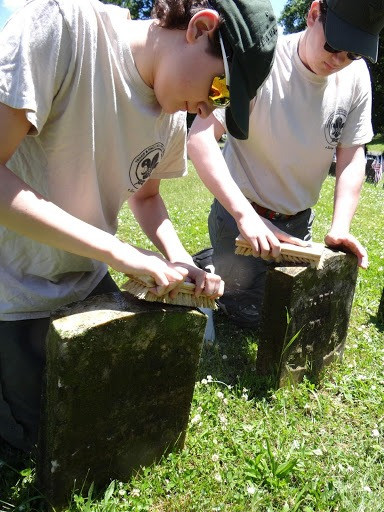 Eliot Jablonski (foreground), Life Scout and Assistant Senior Patroller of Unit 305, works on the restoration of one of the gravestones of Veterans within the Soldiers' Circle at Arlington Cemetery in Kearny for his Eagle Project alongside his brother, Nathaniel Jablonski, Eagle Scout of Unit 305 (photo courtesy of Unit 305 in Kearny)