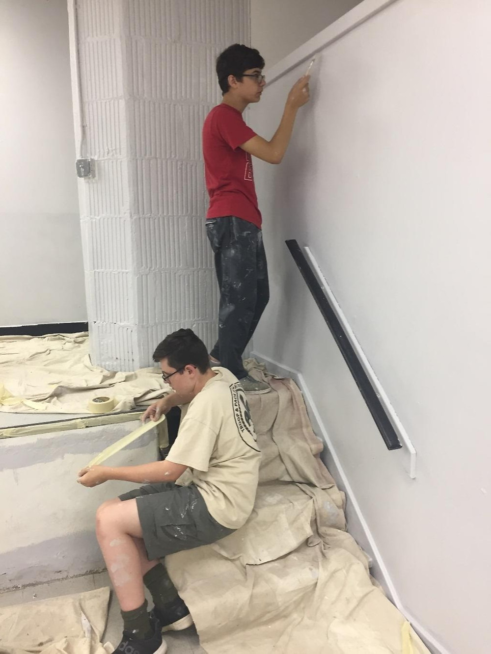 Jonathan Reverendo of Unit 305 (standing) painted the walls as part of his Eagle Project to revitalize Hedges Hall of St. Stephen's Church in Kearny along with fellow Scouts, including Nate Jablonski