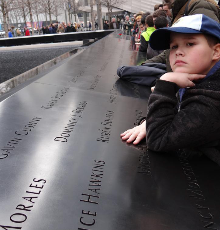 Cub Scout Michael English reflects at the 9/11 Memorial overlooking the fountain on the footprint of one of the Twin Towers