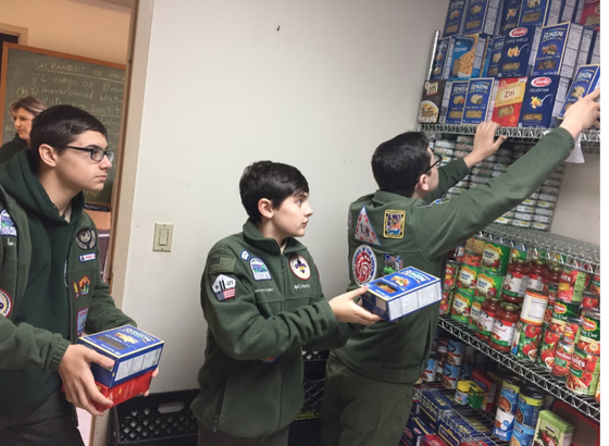 "Unit 305 ""Scouting for Food"" Restocks Food Pantry"