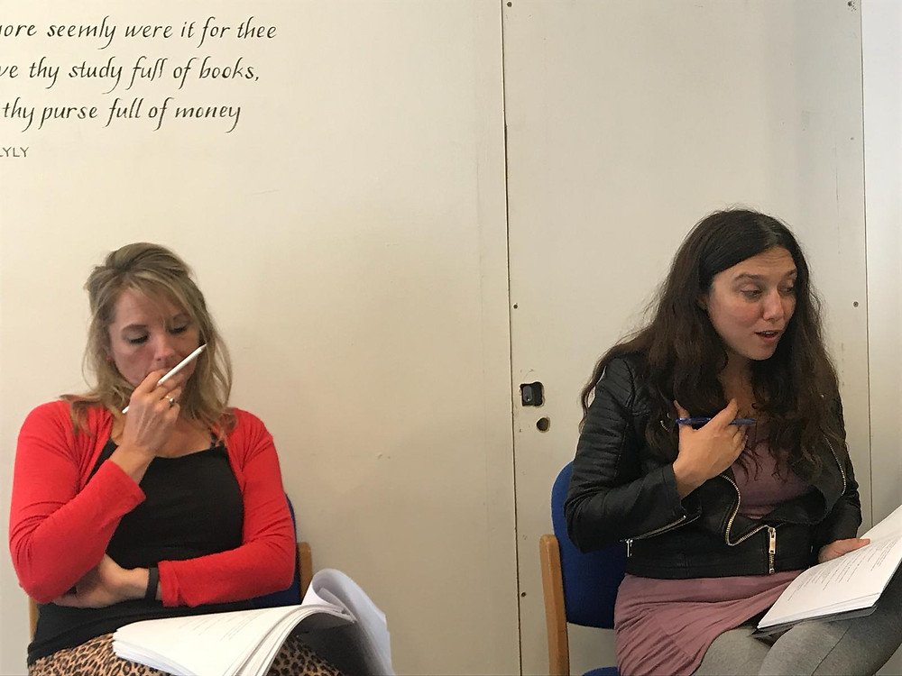 Two ladies reading scripts in the rehearsal room