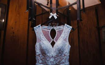 dress hanging in bridal suite
