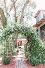 Ceremony Archway Leading into Small Garden